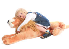 Little blond girl with her toy friend Stock Photos