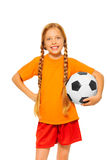 Little blond girl holding soccer ball isolated Stock Image
