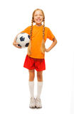 Little blond girl holding soccer ball isolated Royalty Free Stock Photo