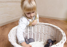 Little blond girl holding a sphynx kitten Stock Photos