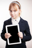 Little blond girl holds tablet device Stock Image