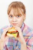 Little blond girl with homemade burger Stock Image