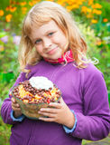Little blond girl with homemade fruit dessert Stock Photo