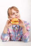 Little blond girl with homemade hamburger Stock Photography