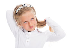 Little blond girl lays his long hair. Stock Image