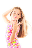 Little blond girl with long hair. On white Royalty Free Stock Image