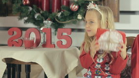 Little blond girl with long hair and wearing a red stock video