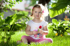 Little blond girl in nature Royalty Free Stock Photos