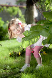 Little blond girl in nature Royalty Free Stock Image