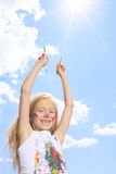 Little blond girl with paint on the face Stock Image