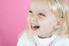 Little blond girl  on pink  background Stock Photos