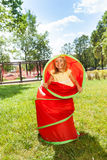 Little blond girl play with toy tube Royalty Free Stock Photography