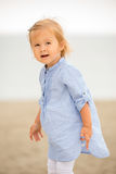Little blond girl playing on the beach Royalty Free Stock Photos