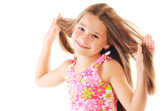 Little blond girl playing with her hair. Portrait of the little blond girl playing with her hair on white background Stock Photography