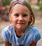 Little blond girl portrait outdoors Royalty Free Stock Photos