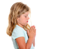Little blond girl praying Stock Photography