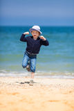 Little blond girl at  sand beach Royalty Free Stock Photo