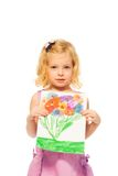 Little blond girl showing her picture Royalty Free Stock Photography