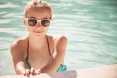 Little blond girl with sunglasses, closeup portrait Stock Photo