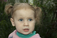 Little blond girl. With surprised looks Stock Photo