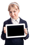 Little blond girl with tablet device on white Stock Images