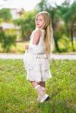 Little blond girl Stock Images