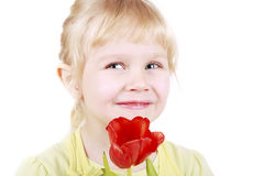 Little Blond Girl With Tulip Royalty Free Stock Image