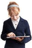 Little blond girl works on tablet device Stock Photography