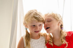 Little blond girls in red and white dress Stock Image