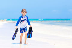 Little blond kid boy having fun on tropical beach of Bora Bora Royalty Free Stock Photo