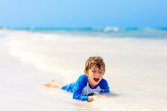 Little blond kid boy having fun on tropical beach of Jamaica Royalty Free Stock Images