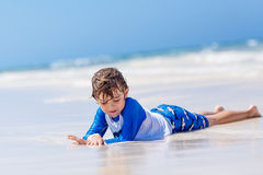 Little blond kid boy having fun on tropical beach of Jamaica Royalty Free Stock Photography