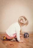 Little Blond Kid Playing with Sphynx Kitten Stock Photo