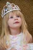 Little Blond Princess. A small blond girl wearing a princess tiara Royalty Free Stock Photo