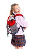 Little blond school girl with backpack bag. Portrait isolated on white background royalty free stock photography
