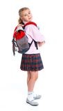 Little blond school girl with backpack bag. Portrait isolated on white background royalty free stock photos