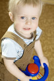 Little blond smiling boy Stock Photo