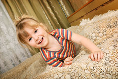 Little blond smiling girl lying Royalty Free Stock Photography