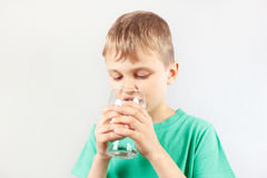 Little blonde boy drinking fresh mineral water Royalty Free Stock Images