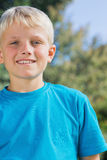 Little blonde boy smiling at camera Royalty Free Stock Photography