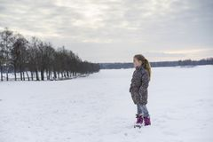 Little blonde caucasian Swedish girl standing outdoor in winter landscape Royalty Free Stock Photography