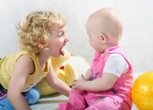 Little blonde curly girls. With toy on the white with toy Royalty Free Stock Photography