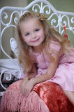 Little blonde girl. In a pink dress Stock Images
