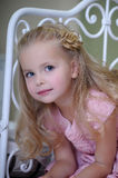 Little blonde girl. In a pink dress Stock Photos