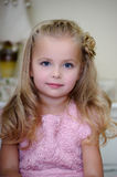Little blonde girl. In a pink dress Stock Image