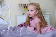 Little blonde girl. In a pink dress Royalty Free Stock Photos