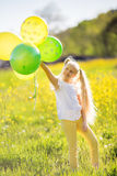 Little blonde girl with balloons Royalty Free Stock Photography