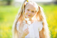 Little blonde girl with dandelion Royalty Free Stock Photography