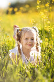 Little blonde girl with dandelion flower Royalty Free Stock Photography