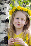 Little blonde girl in dandelion wreath Stock Image